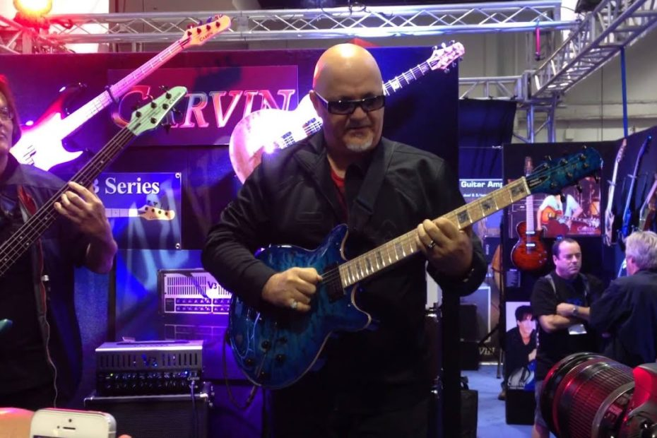 Frank Gambale and Bunny Brunel Carvin Booth 2014 NAMM - GuitarLessons.com